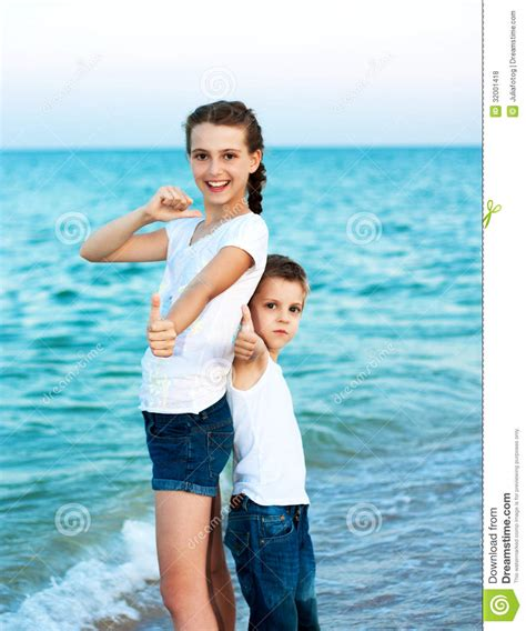 Sister And Brother On The Evening Beach
